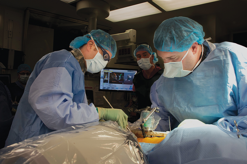 Doctors of the UConn Musculoskeletal Institute's Comprehensive Spine Center use the Mazor Robotics Renaissance Guidance System to perform spine surgery in January.
