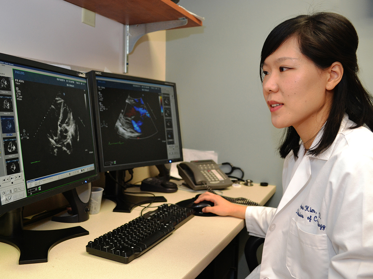 Dr. Agnes Kim, director of the Cardio-Oncology Program at UConn Health, analyzes echocardiography images as one way to monitor cancer patients' risk of heart disease.