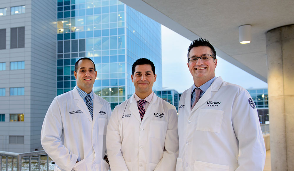 3 doctors stand together, Dr. Craig Rodner (left), Dr. Joel Ferreira (center), and  Dr. Anthony Parrino (right) Farmington, Southington