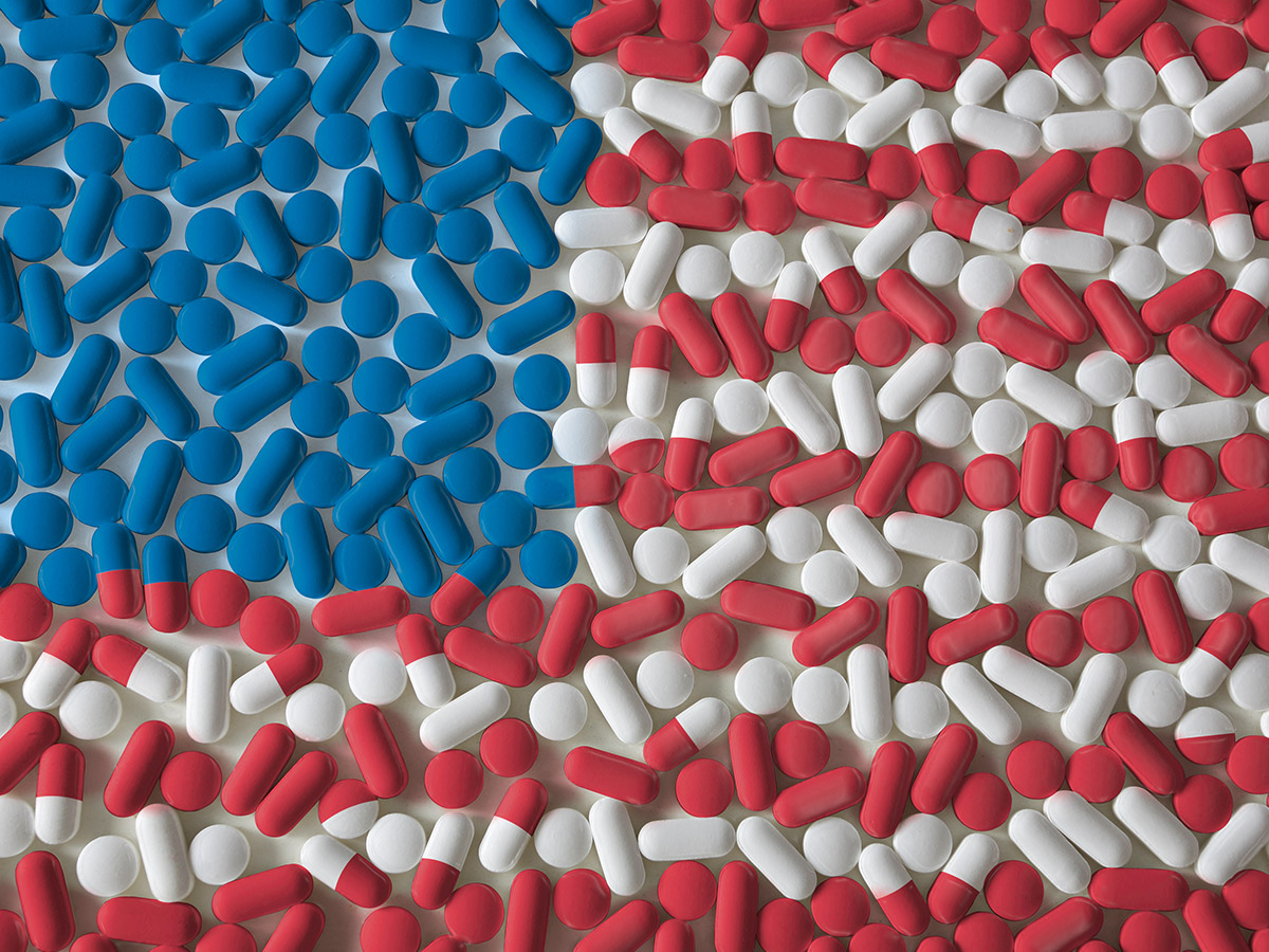 Red, white, and blue pills combined to form the American flag