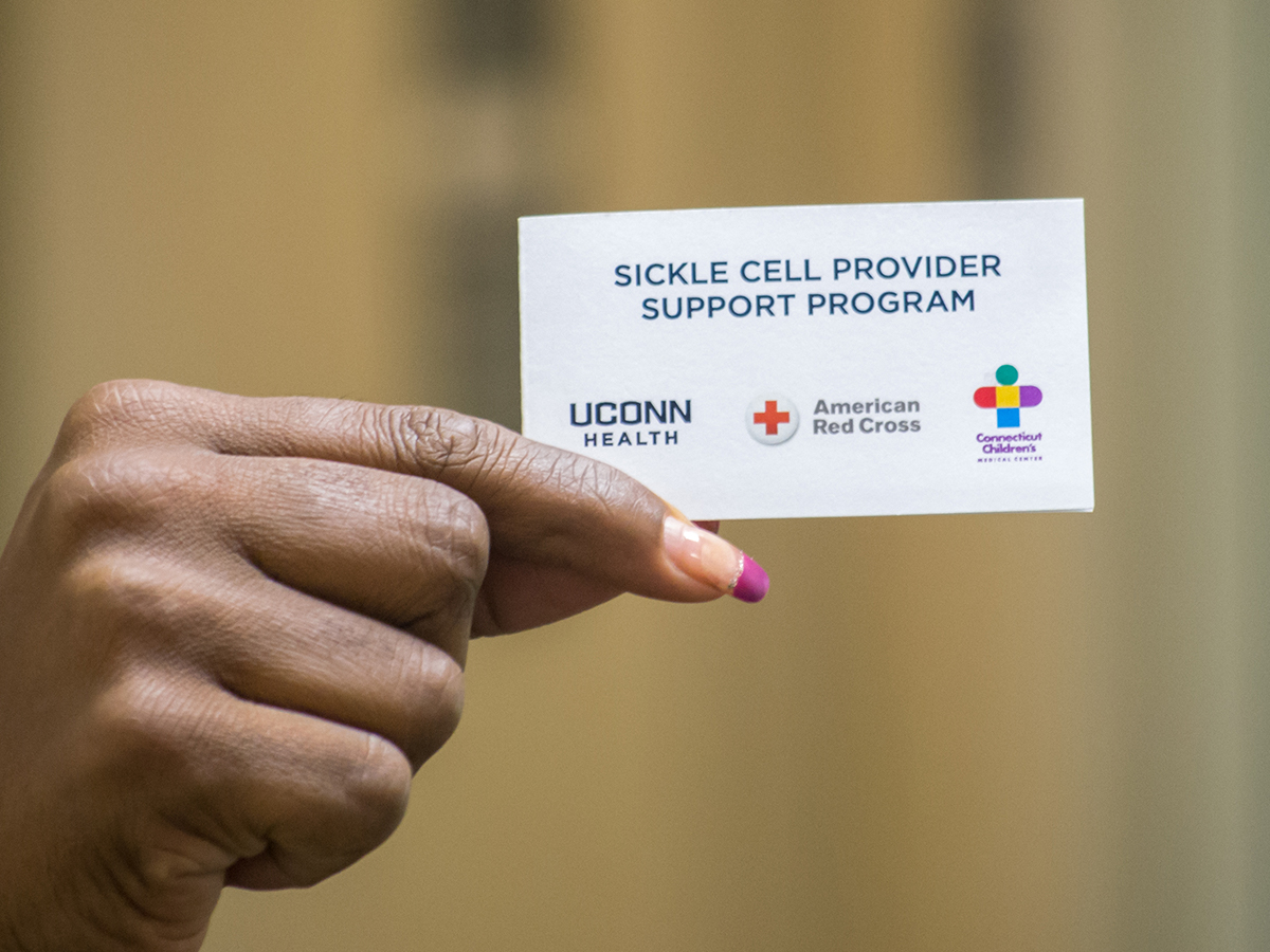 Hand holds sickle cell ID card