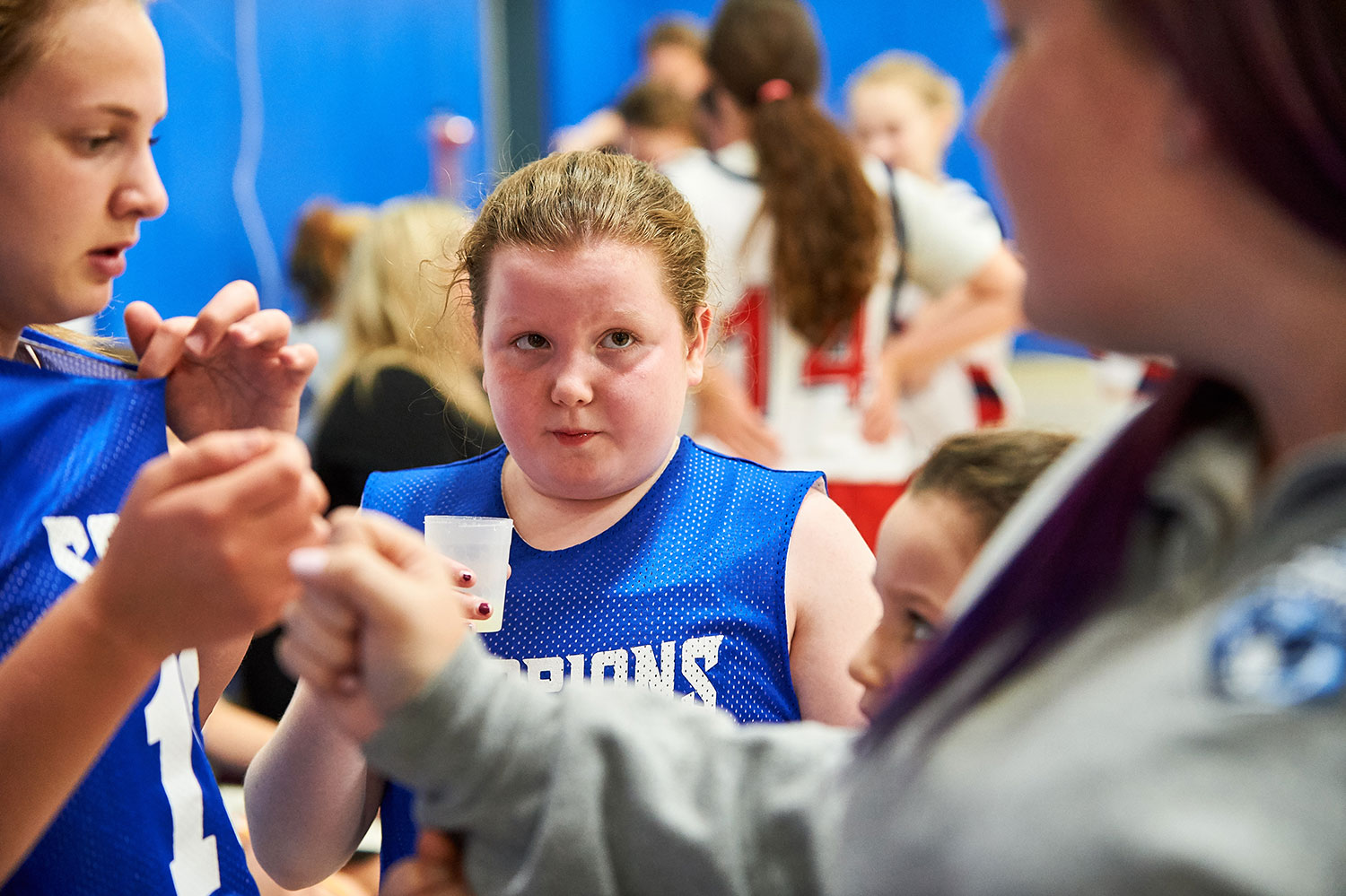 Alyssa Temkin, 11, takes a break during a basketball game