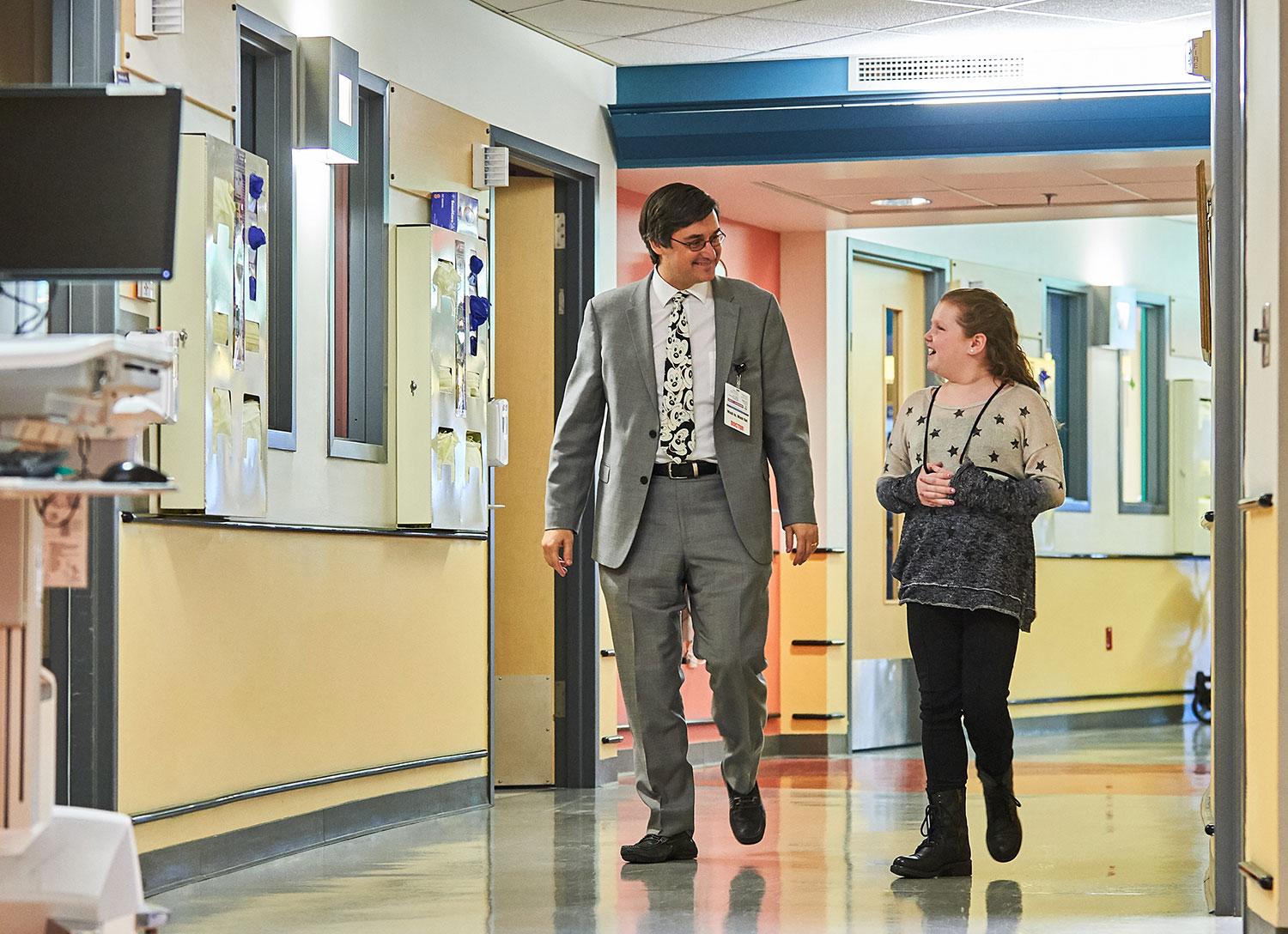Dr. David Weinstein, head of the Glycogen Storage Disease Program at UConn Health and Connecticut Children's Medical Center, walks with Alyssa Temkin through the new clinic at Connecticut Children's.