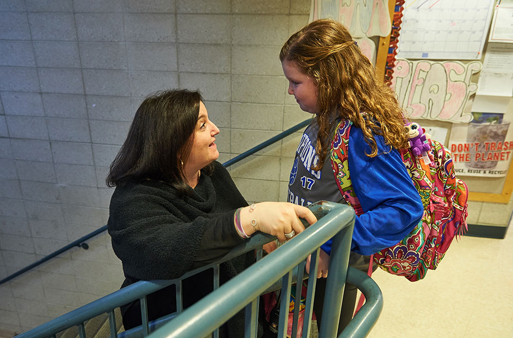 Gayle Temkin talks to her daughter Alyssa in a school stairwell.