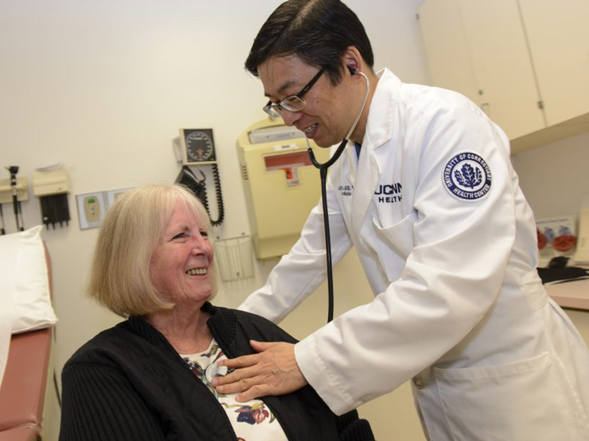 UConn Doctor checks patient's heart