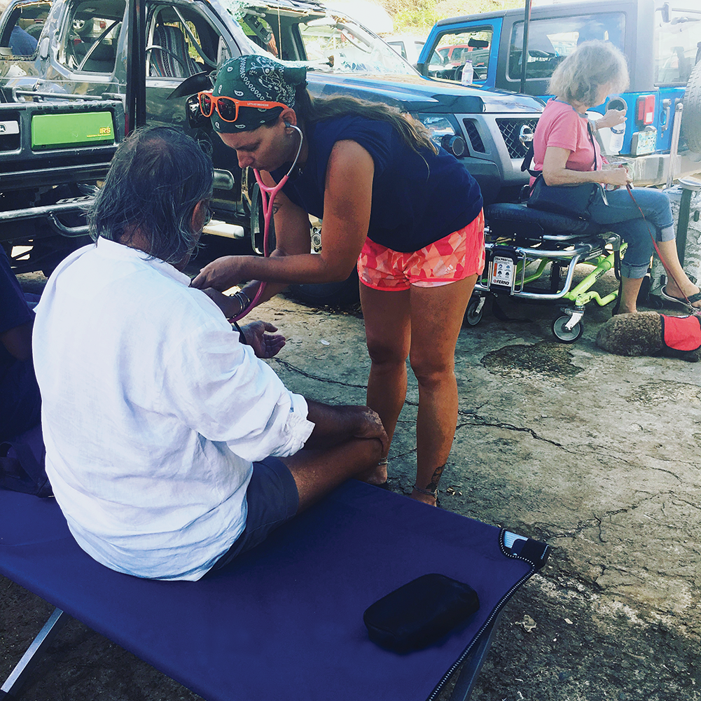 a fellow volunteer caring for a resident of St. John following Hurricane Irma.