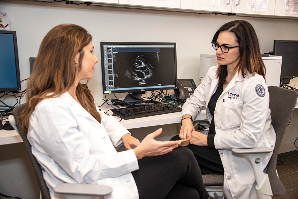 Dr. Fernanda Wajnzsztajn (left) and Dr. Sarah Tabtabai discuss a patient case.