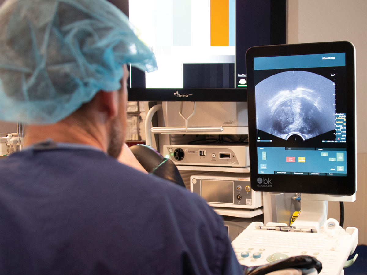 Dr. Ben Ristau uses ultrasound to guide a transperineal prostate biopsy.